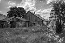 Old destroyed wooden house. Black and white photo