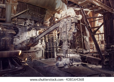 Old devices for opening the iron taphole in blast furnace workshop on Mining and metallurgical plant Stock fotó ©