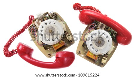 Old Dial Phones on White Background - stock photo