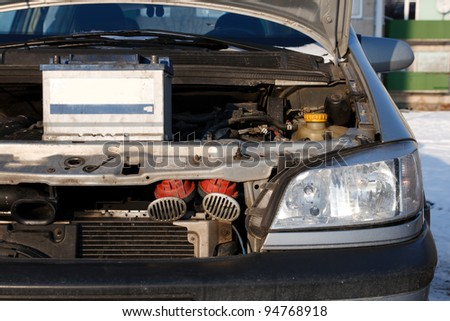 old diesel engine car don't work in winter.Need to charge the battery. - stock photo