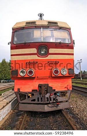 old diesel locomotive on railway station