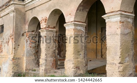 Old dilapidated building facade with columns