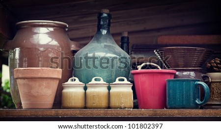 old dirty containers and flowerpots in shelf