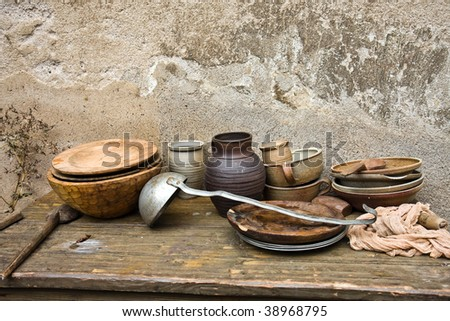 old dirty dishes on table - stock photo