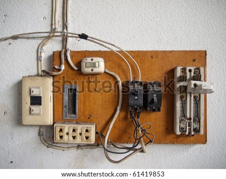 old dirty Electrical in wood panel on wall