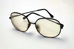Old dirty eye glasses, dangerous eye ware high risk of infection, major cause of blindness that affect quality of living, working and economic problem