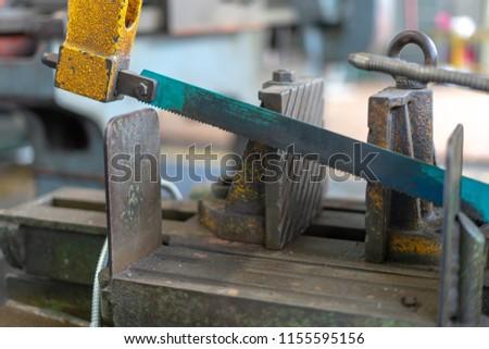 old dirty hacksaw machine industry tool.