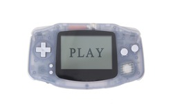 Old dirty portable game console with a small screen - play