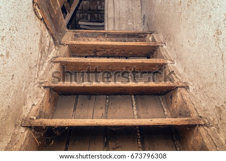 old dirty retro stairs to attic ...