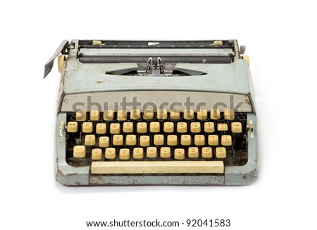Old dirty retro typewriter isolated white background - stock photo