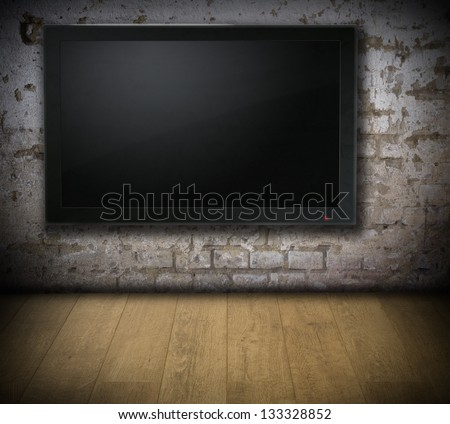 Old dirty room with blank TV screen - for Your text or picture