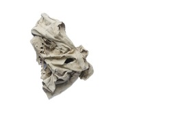 Old dirty torn rag isolated on white background. Cleaning rag.