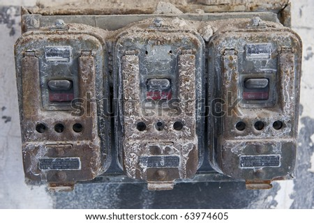 Old dirty wall switches in a derelict building