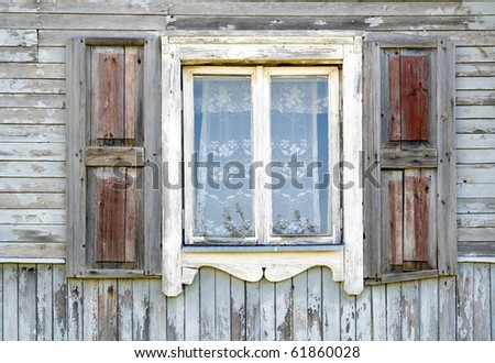 Old dirty white window in the old wooden house texture. The old age concept.