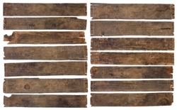 Old dirty wooden plank boards naturally weathered and stained isolated on white background.