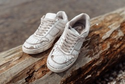 old discarded white shoes on the street
