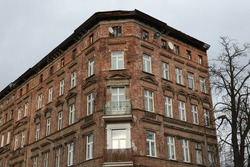 Old disgraced tenement houses in Wrocław, ruins made of red brick