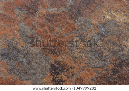 Old Distressed Brown Terracotta Copper Rusty Stone Background with Rough Texture Multicolored Inclusions. Stained Gradient Coarse Grainy Surface. Wallpaper Template