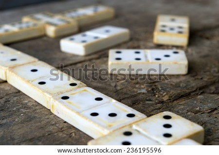 Old domino game on wood background