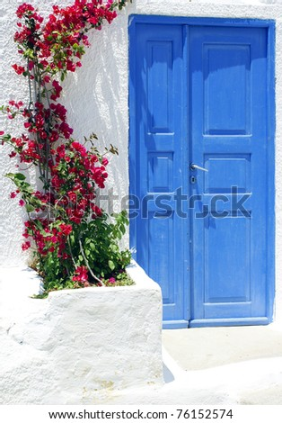 Old door and flowers on Santorini island, Greece
