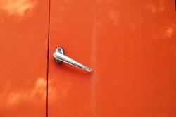 Old door handle. Antique truck door.