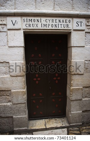 Old door in the Old City of Jerusalem (Simoni Cyrenaeo Crux Imponitur)