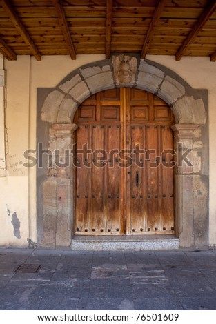 Old door in the square of Astorga