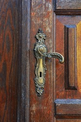 Old door knob on the brown door