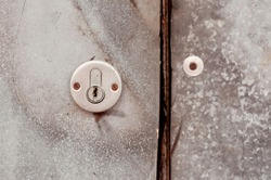 old door lock on a metal surface with rusty nails