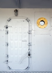 old  Door on an ship and porthole
