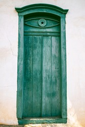 old door on facade of house in Santana do Parnaiba, historic city of colonial period of Brazil. Founded in 1580 It is official historical heritage.