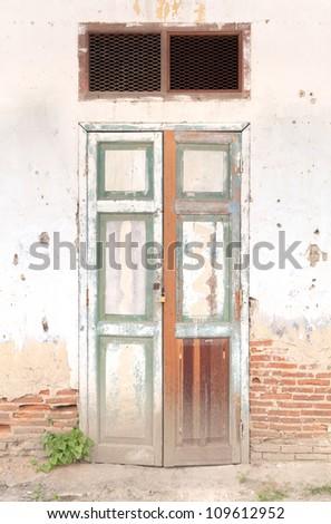 old door on the brick wall