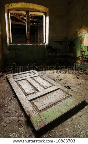 Old door on the floor and window without window-panes - stock photo