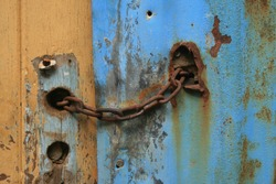 old door rusted chain lock