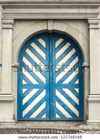 Old door with blue and white strip in Lucerne, Swiss