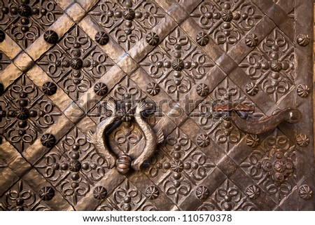 Old door with ornament in Royal Wawel Castle, Kracow, Poland.