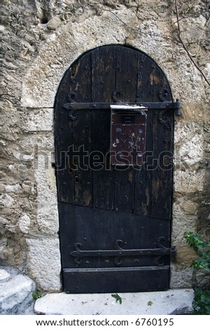 Old door with the postbox in the ancient house