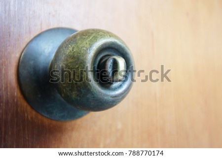 Old doorknob on wooden door