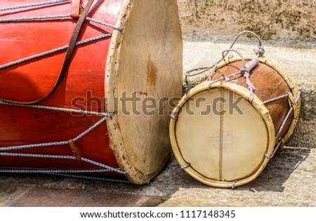 Old drums used in Catholic procession in street in Guatemala