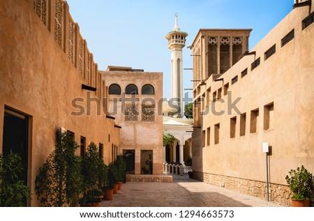 Old Dubai view with mosque, buildings and traditional Arabian street. Historical Al Fahidi neighbourhood, Al Bastakiya. Heritage district in United Arab Emirates (UAE).