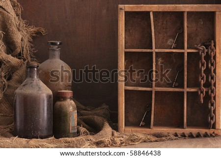 old dusty bottles on wood background, copy space