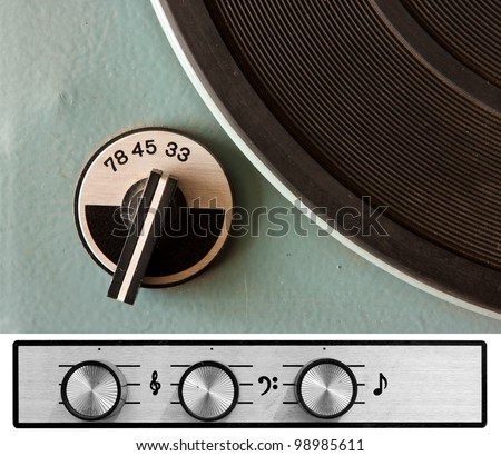Old dusty vinyl player controls - stock photo