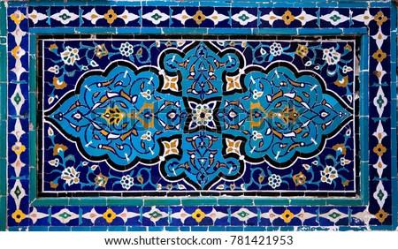 Old Eastern mosaic on the wall, Uzbekistan #781421953