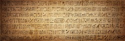 Old Egyptian hieroglyphs on an ancient background. Wide historical background. Ancient Egyptian hieroglyphs as a symbol of the history of the Earth.