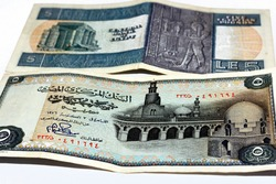 old 5 Egyptian pounds banknote Issue year 1976, Observe side has an image of The Mosque of Ibn Tulun and reverse side has an image of A Pharaonic engraving of Hapi and an ancient Egyptian temple