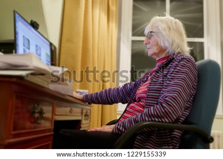 Old elderly senior person learning computer and online internet skills  #1229155339