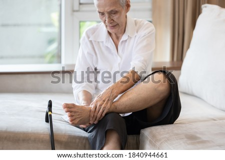 Old elderly with foot injuries,ankle bone diseases,heel pain or soles,asian senior woman suffering from peripheral neuropathy,beriberi,nerve inflammation of the foot, numbness of the feet and toe Stock photo ©