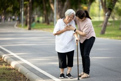 Old elderly with short of breath and chest pain from heart disease, heart attack or heart failure while walking to exercise in outdoor at the park,senior woman with illness,symptoms of dyspnea,angina