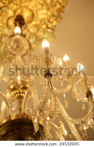 Old electric chandelier lamp, luxury decoration and lighting - stock photo