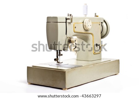 Old electrical sewing machine isolated on white
